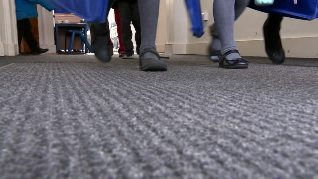low angle view inside a primary school corridor - school building stock videos & royalty-free footage