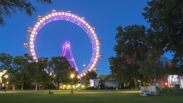 low angle view: observation wheel in prater park  of vienna at twilight, austria - prater park stock videos & royalty-free footage
