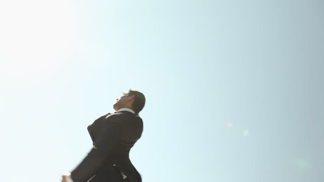 Low angle view of a businessman celebrating his success