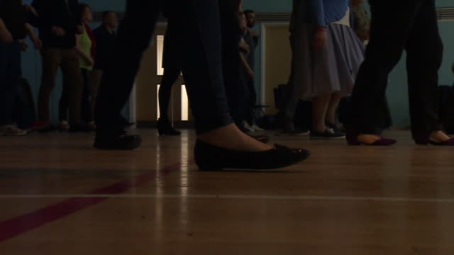vidéos et rushes de low angle view of a jive dancing class - rock