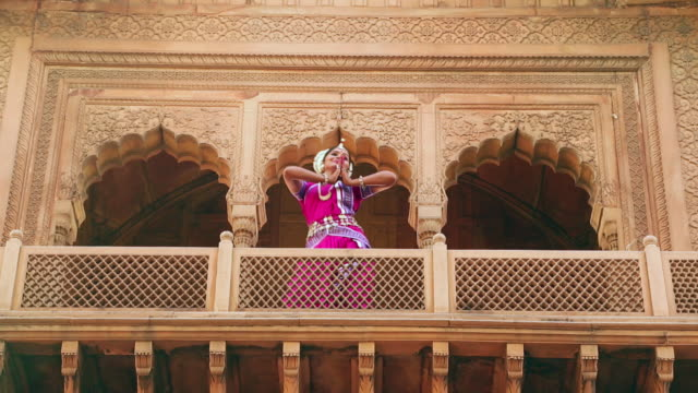 Low angle view of a odissi dancer performing in the palace, Ballabgarh, Haryana, India