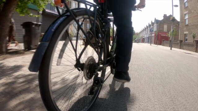 low angle view of a person cycling - low angle view stock videos & royalty-free footage