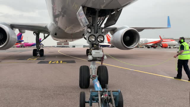 low angle view of a plane taxiing at an airport - low angle view stock videos & royalty-free footage