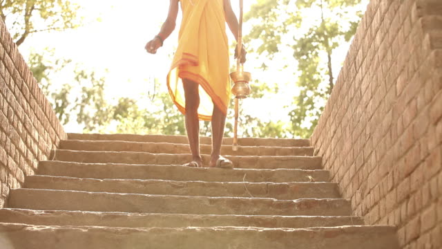 low angle view of a sage walking down stairs, faridabad, haryana, india - only mature men stock videos & royalty-free footage