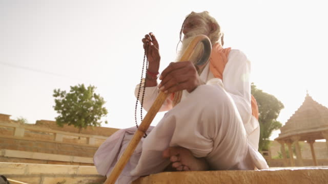 low angle view of a sage worshipping, jaisalmer, rajasthan, india - guru stock videos & royalty-free footage
