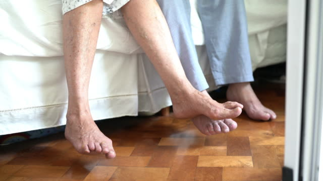 low angle view of a senior couple's feet on the side of bed - touching stock videos & royalty-free footage