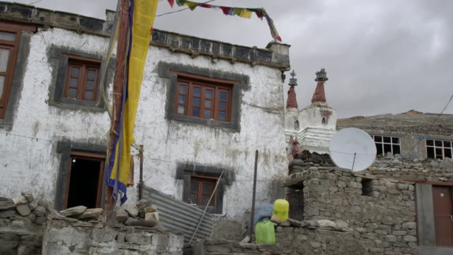 low angle view of a typical tibetan stone house in the village of karzok in ladakh, india - religion stock videos & royalty-free footage