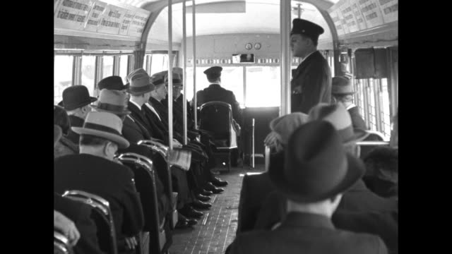low angle view of an electric art deco commuter train car the railcarbus rolling past / vs seen from inside the moving vehicle seated commuters and... - passing a note stock videos and b-roll footage