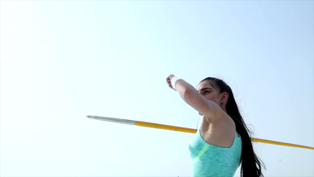 Low angle view of athlete throwing javelin, Delhi, India