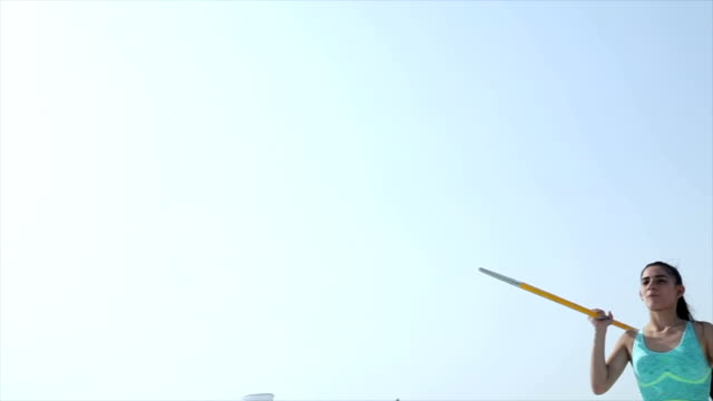 low angle view of athlete throwing javelin, delhi, india - javelin stock videos & royalty-free footage