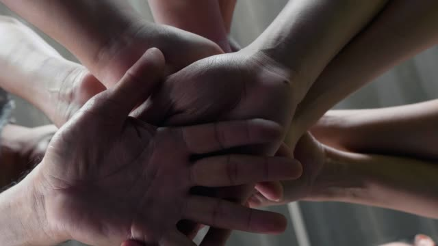 low angle view of athletes stacking hands together in health club - basketball sport stock videos & royalty-free footage
