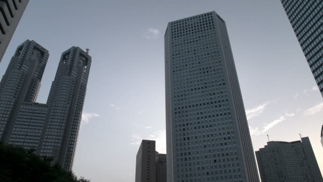 low angle view of buildings in shinjuku. tokyo,japan - low angle view stock videos & royalty-free footage