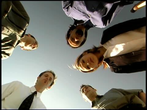 stockvideo's en b-roll-footage met low angle view of business people looking at camera - bukken