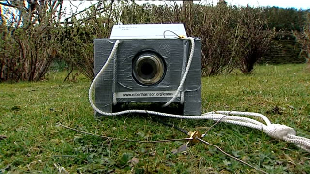 ext low angle view of camera inside polystyrene case robert harrison's house pan and zoom in on moon in sky - polystyrene stock videos & royalty-free footage