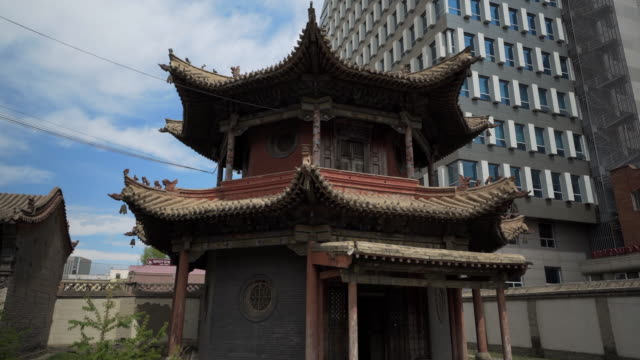 low angle view of choijin lama temple against building in city - ulaanbaatar, mongolia - monastery stock videos & royalty-free footage
