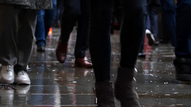 low angle view of city commuters in the rain. - incidental people stock videos & royalty-free footage