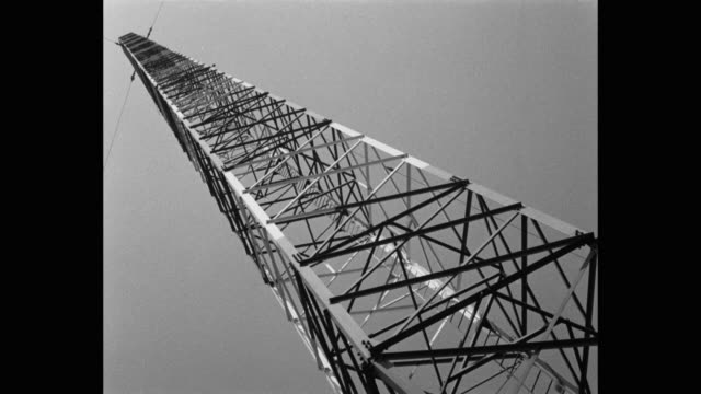 low angle view of communication tower against sky - communications tower stock videos & royalty-free footage