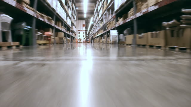low angle view of corridor in megastore/warehouse with packages - megastore stock videos & royalty-free footage