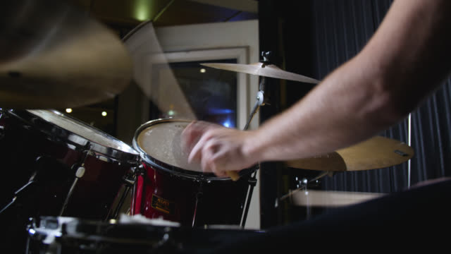 vidéos et rushes de low angle view of cymbals and drums being hit in quick succession on a drum kit - drummer