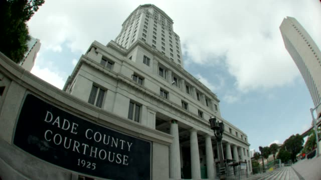 low angle view of dade county courthouse in miami shot through fish-eye lens - miami dade county stock videos & royalty-free footage