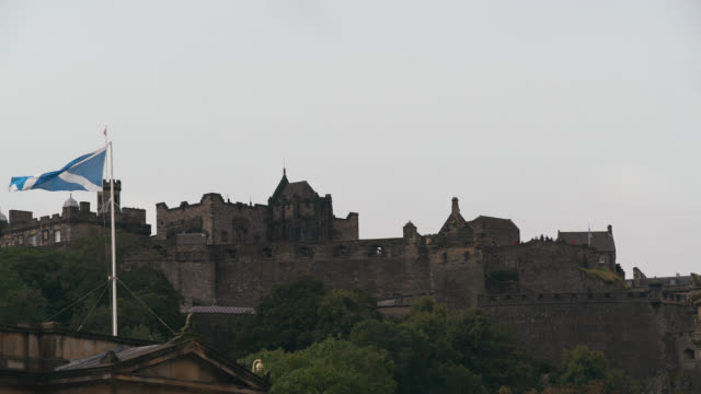 low angle view of edinburgh castle, scotland - scottish flag stock videos & royalty-free footage