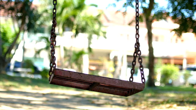 low angle view of empty swing in park - swinging stock videos & royalty-free footage
