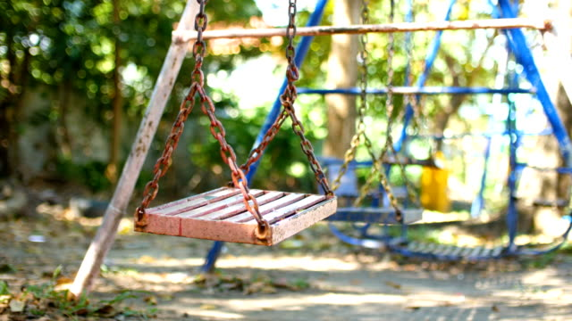 low angle view of empty swing in park - swing play equipment stock videos and b-roll footage