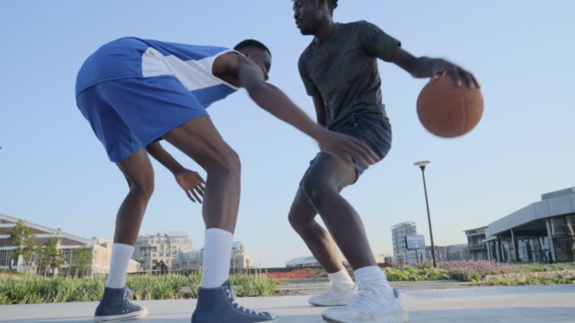 low angle view of expert basketball players facing off - after work stock videos & royalty-free footage