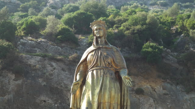 low angle view of figurine of the virgin mary, golden religion art and symbol, at selcuk, izmir, turkey. concept of christianity sculpture. - pilgrim stock videos & royalty-free footage