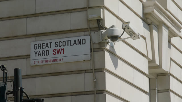 low angle view of great scotland yard street sign - whitehall london stock videos & royalty-free footage