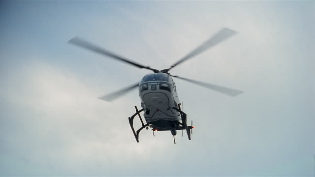 low angle view of helicopter landing on helipad outside hospital - helicopter landing stock videos & royalty-free footage