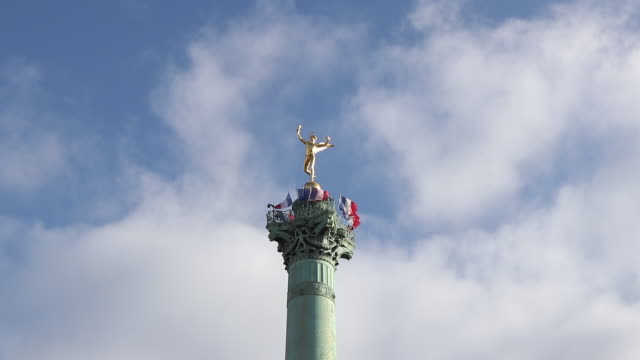 low angle view of july column against blue sky with clouds at place de la bastille, paris - french revolution stock videos & royalty-free footage