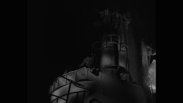 low angle view of men getting injured in shell explosion on bridge of submarine at night - binoculars stock videos & royalty-free footage