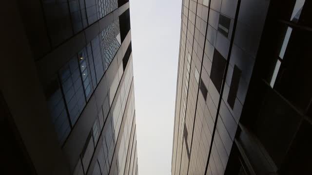 low angle view of modern office buildings in beijing - fönsterrad bildbanksvideor och videomaterial från bakom kulisserna