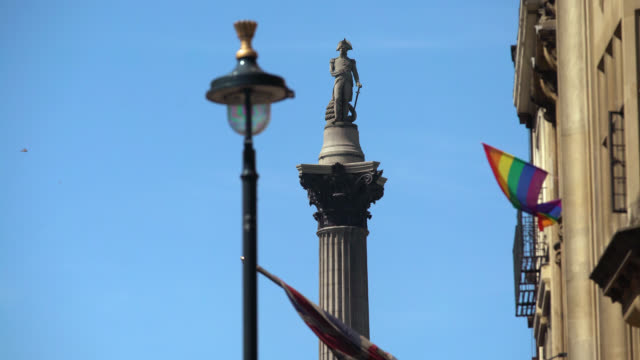 low angle view of nelson's column under blue sky - male likeness stock videos & royalty-free footage