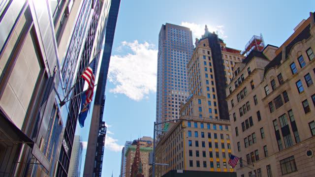low angle view of new york financial offices. american flag. - manhattan financial district stock videos & royalty-free footage