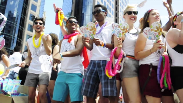 low angle view of people dancing on a float partaking on the toronto gay pride parade of the year 2013 the event is a tradition in the important... - festwagen stock-videos und b-roll-filmmaterial