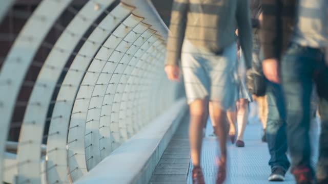 low angle view of people walking across millenium bridge - suspension bridge stock videos & royalty-free footage