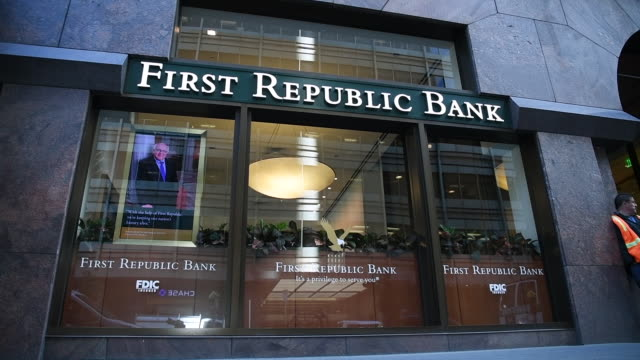low angle view of people walking past exterior of first republic bank in san francisco california on friday march 31 2017 - bankenschild stock-videos und b-roll-filmmaterial