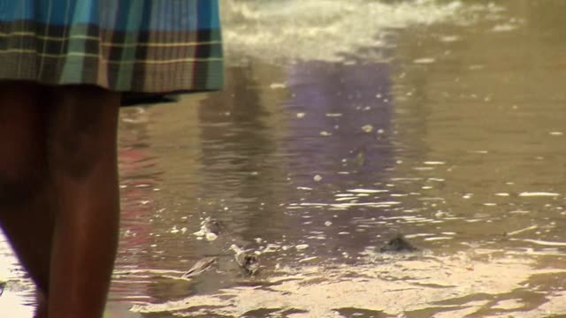 low angle view of people walking through floodwater in beira mozambique caused by cyclone idai - cyclone stock videos and b-roll footage