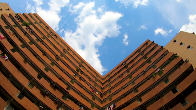 vidéos et rushes de low angle view of residential area buildings with blue sky, time lapse - toit en tuiles