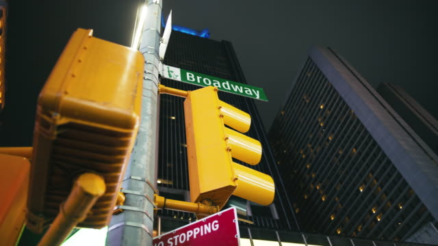 low angle view of road signal and buildings in city - broadway manhattan stock videos & royalty-free footage