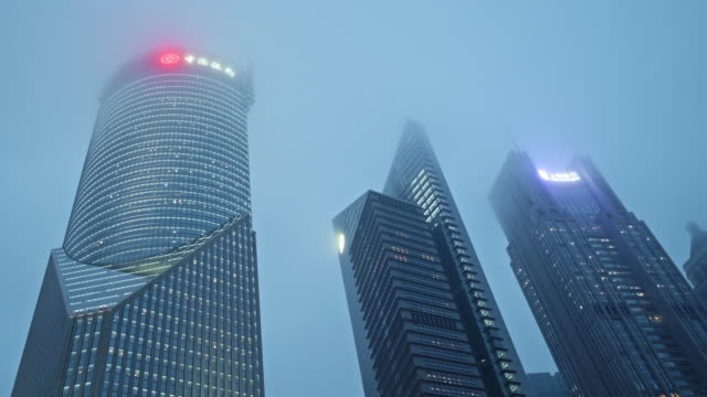 low angle view of shanghai landmarks in fog - china east asia stock videos & royalty-free footage
