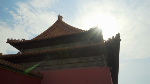low angle view of sunlight falling on historic building in forbidden city against sky - beijing, china - forbidden city stock videos & royalty-free footage