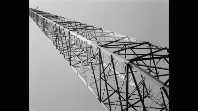 low angle view of telecommunication tower against sky - mast stock videos & royalty-free footage