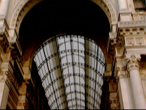 low angle view of the archway of the galleria vittorio emanuele ii / tilt down long shot of pedestrians in the arcade / milan, italy - galleria vittorio emanuele ii stock videos and b-roll footage