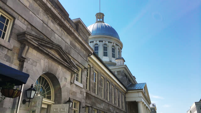 low angle view of the bonsecours market and cupola on june 11, 2017; in old montreal, quebec, canada. old montreal is a unesco world heritage site... - モントリオール旧市街点の映像素材/bロール
