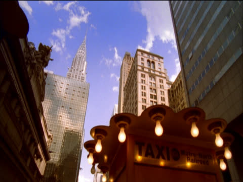 low angle view of the chrysler building, grand central station and an illuminated taxi rank, new york, usa - taxi rank stock videos & royalty-free footage