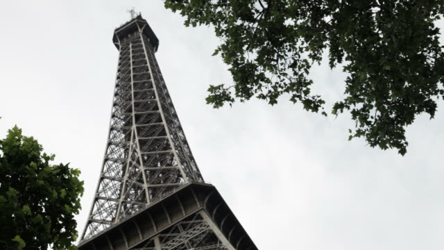 low angle view of the eiffel tower in paris, france - desaturated stock videos & royalty-free footage
