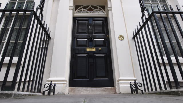 stockvideo's en b-roll-footage met low angle view of the entrance to 11 downing street on october 31 2016 in london england - downing street